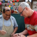 Local artisan from Pachacamac sharing with a traveler on a tour with RESPONSible Travel Peru