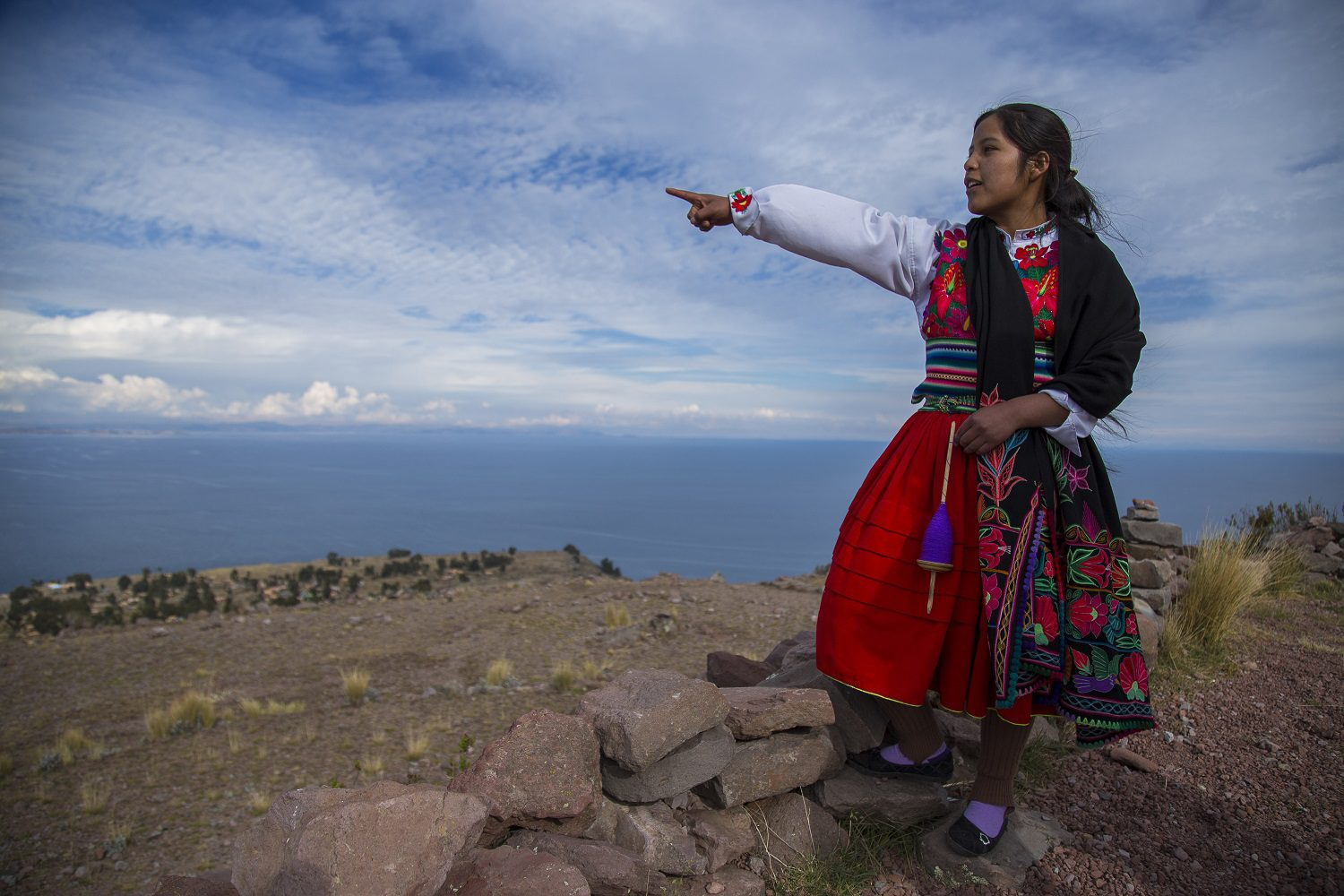 11local guide points out over Lake Titicaca from Amantani Island