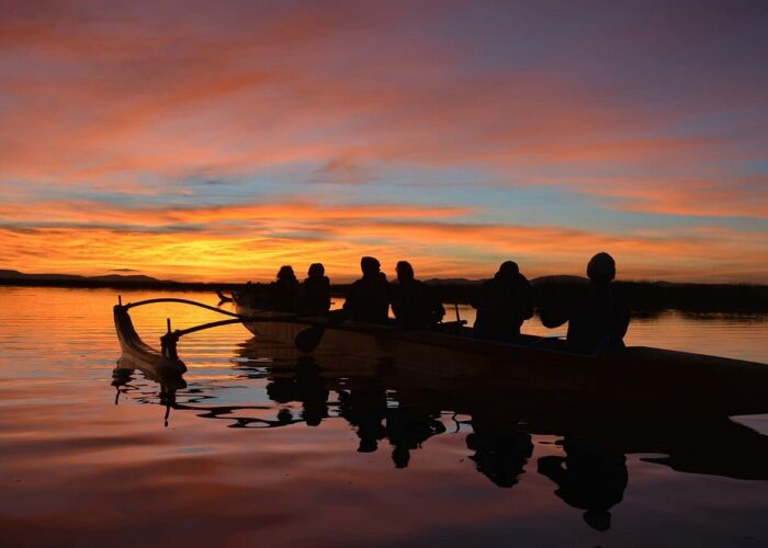 Row on Lake Titicaca in a Polynesian Canoe by sunset - RESPONSible Travel Peru