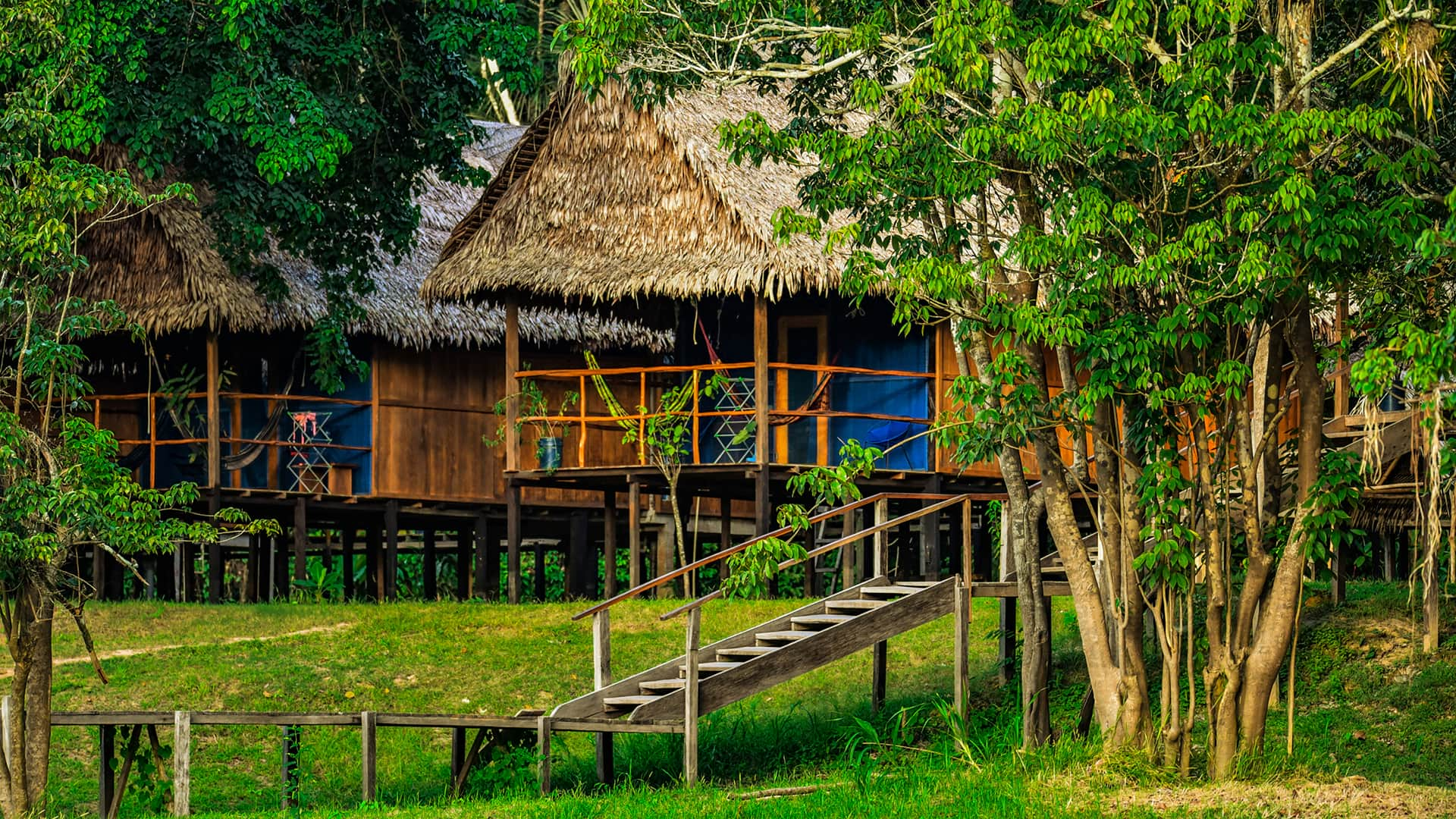11Traditional Amazonian buildings are characteristic of the lodge | Responsible Travel Peru