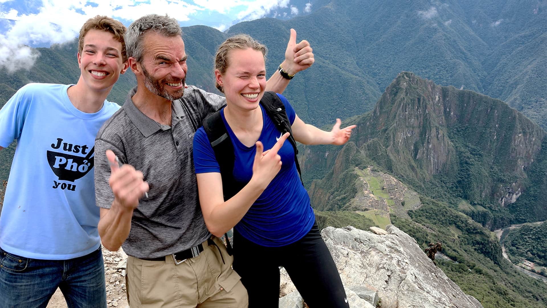 Family portrait in Machu Picchu from the old mountain lookout | Responsible Travel Peru