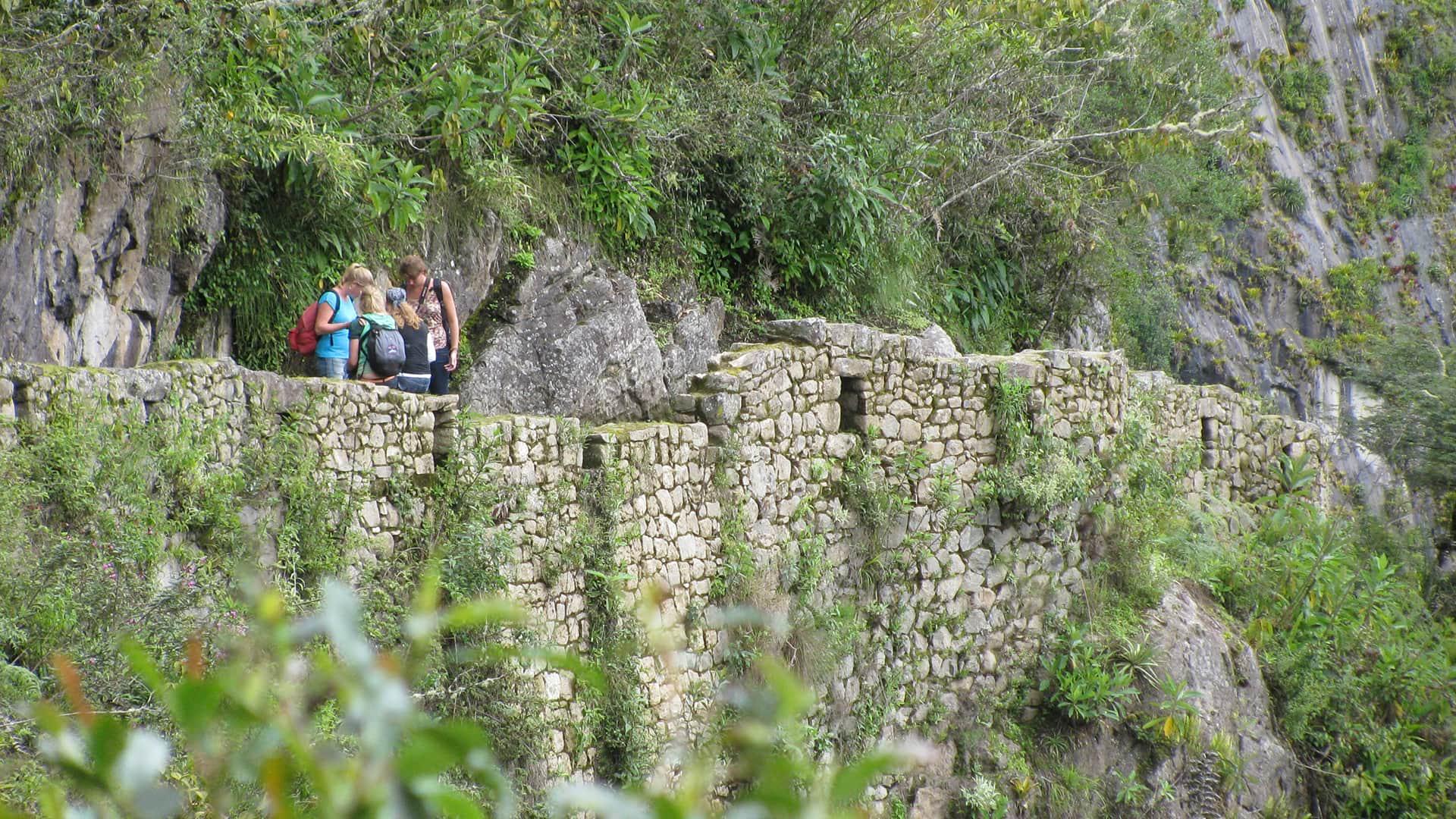Four girls standing on the way to the Inca bridge in Machu Picchu | Responsible Travel Peru