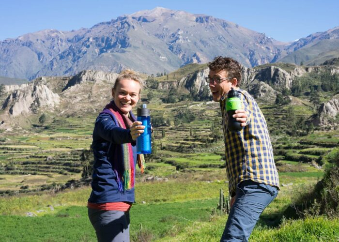 11Agnes and Guido from RESPONSible Travel Peru are proudly showing their water bottles with built-in filter on a Road trip through Peru